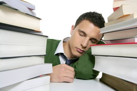 boy student sleeping over stack books over desk, green shirt and tie Stock Photo - 4400409