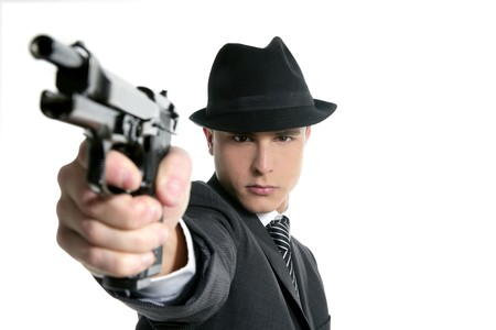Classic mafia portrait, man with black suit and gun, isolated on white Stock Photo