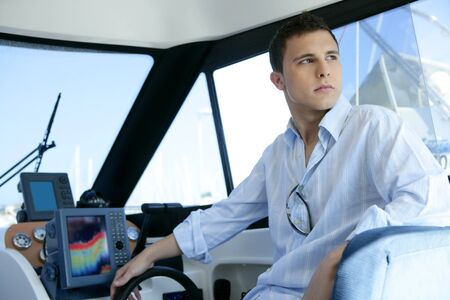 Young handsome man on a yacht boat interior in summer Stock Photo - 4400469