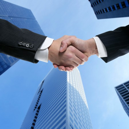 greeting people: Businessman teamwork partners shaking hands with suit
