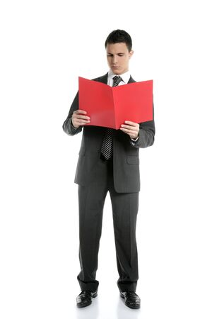 Full body businessman reading red folder isolated on white at studio photo