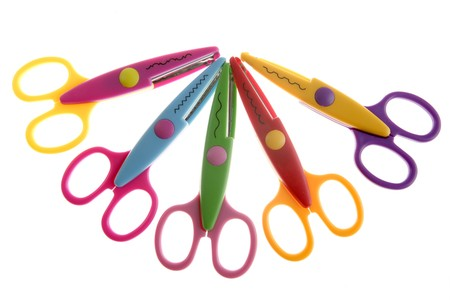 Little student colorful plastic scissors isolated over white photo