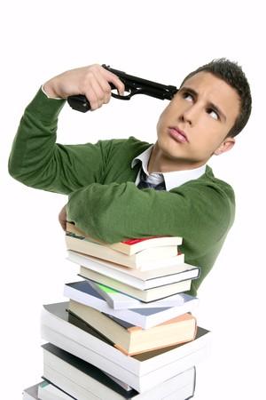 Unhappy sad student suicide gun metaphor, stacked books over white photo