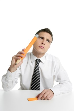Young businessman student thinking gesture with huge giant pencil photo