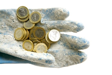 Dirty money metaphor. Euro currency coins over dirty gloves photo
