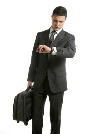 Businessman look his watch with handbag isolated on white photo
