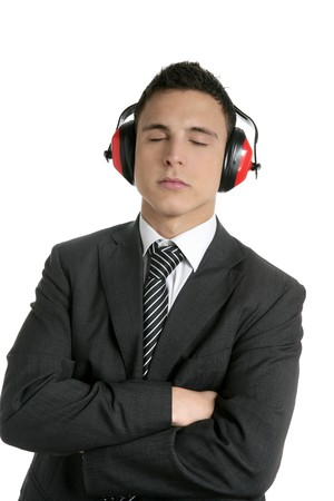 Young businessman protecting ears from noise with safety headphones photo