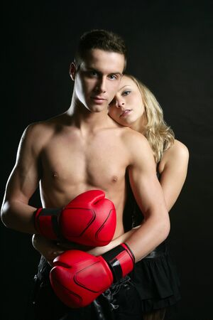 Sexy young male boxer with blond beautiful girl, isolated on black studio shot photo