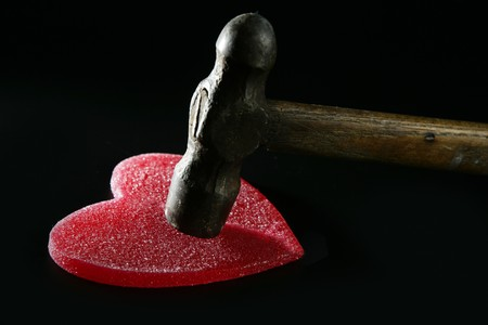 Breaking the love or the health, hammer beating a red heart