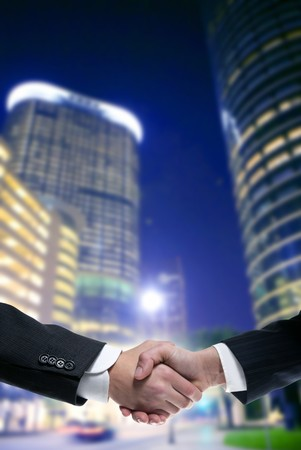 Businessman teamwork partners shaking hands with suit Stock Photo - 4439850