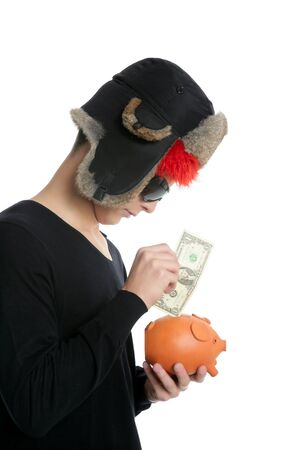 Crazy young student boy, one dollar in piggy bank with winter hat photo