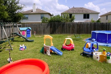 Children colorful playground at home over green grass Stock Photo - 4460356