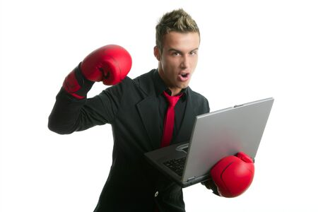 Angry with laptop computer young boxer businessman over white photo