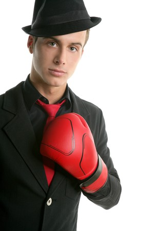 Businessman with red boxer gloves isolated over white photo