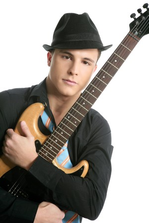 young sexy male guitar player, tie and black hat, isolated on white photo