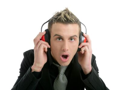 Businessman scared of noise isolate with safety headphones photo