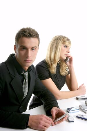 Helpdesk metaphor with many telephones. young business couple photo