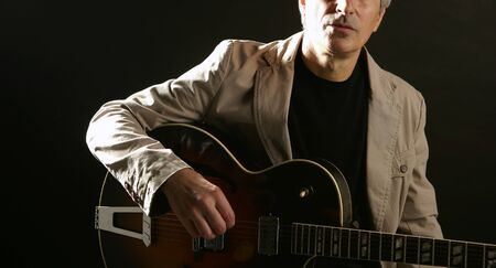 Jazz guitar player playing classic instrument photo
