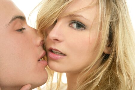 Couple natural kiss close up portrait over white background Stock Photo - 4484389