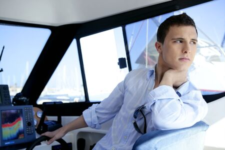 sailor man: Young handsome man on a yacht boat interior in summer
