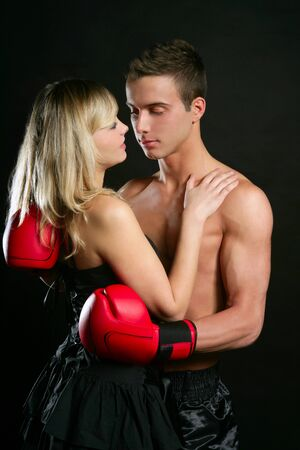 Young beautiful couple of blond girl and handsome boxer man photo