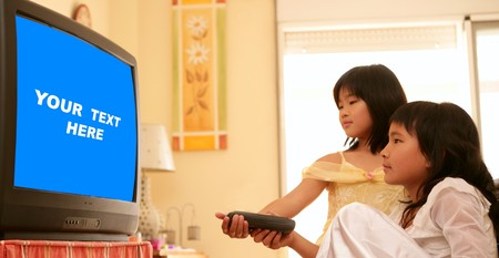 tv remote: two asian girls dressed as princess, tv remote control, blue copy space Stock Photo