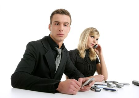Business couple with many mobile telephones, isolated over white Stock Photo - 4516255