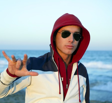 Grunge young man with hood and sunglasses at the beach Stock Photo - 4516285
