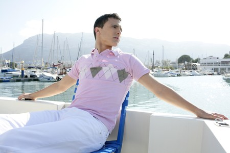 Young handsome man relaxed in vacation with his boat