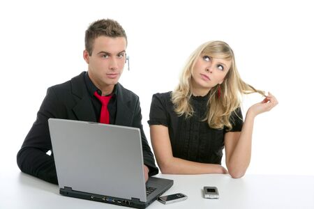 Young business couple dress in black with laptop isolated on white photo