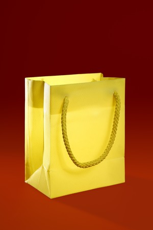 Shopping bag, shopper woman metaphor over red background photo