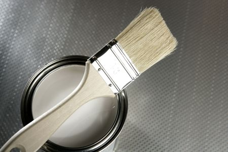 Painter brush and white paint tin macro over silver pattern background Stock Photo - 4588110