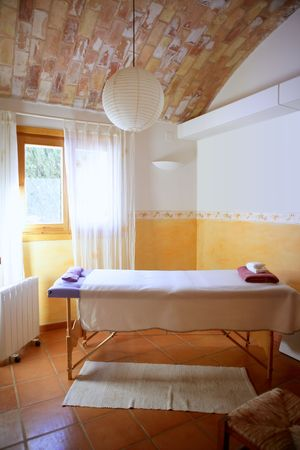 window treatments: Nice massage room with barrel vault on clay bricks, Mediterranean interior house