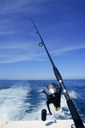 Fishing rod and reel on a boat, vacation on blue sea and summer sky Stock Photo - 4590759