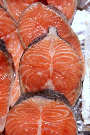 white salmon river: Salmon fish vivid slices in a row, marketplace textures Stock Photo