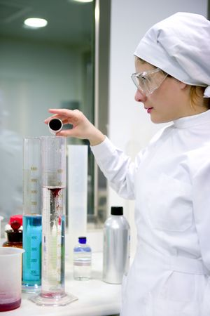 Chemical research laboratory, woman working, glass cylinder vase Stock Photo - 4610016