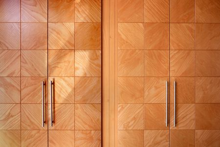 Wooden office modern closet orange doors, interior design Stock Photo - 4609874
