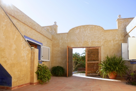 courtyard: Spanish golden wall mediterranean style house, nice courtyard Stock Photo