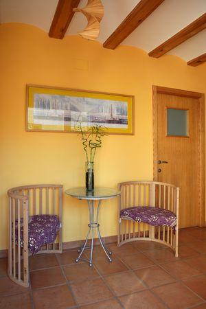Lobbit, corridor in yellow color with wooden beams interior photo