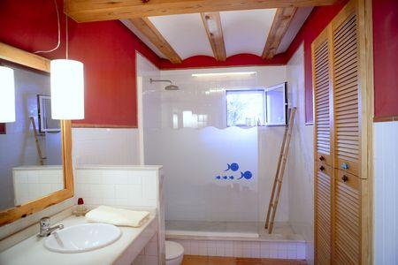 Nice warm white bathroom, red walls natural light interior photo