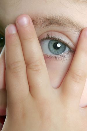 shy girl: Little shy girl hide her face with fingers, blue eye