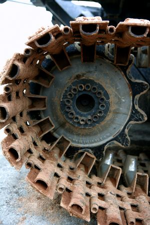Caterpillars steel details and wheels from a snowblower vehicle photo