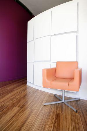 Modern office lobby interior design, orange leather chair , wooden floor photo