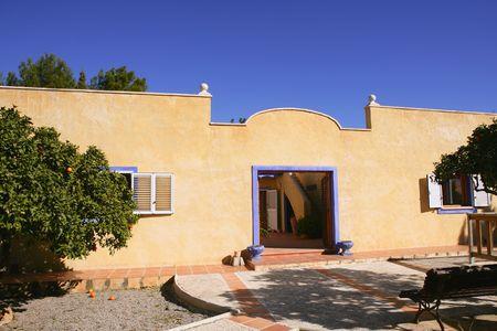 Spanish golden wall mediterranean style house, nice courtyard photo