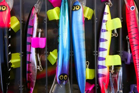 Colorful fishing saltwater fish lures in a box, rusted hooks Stock Photo - 4610297
