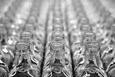 Glass square transparent bottles, factory lines and rows Stock Photo