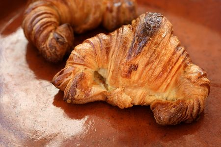 Two croissant pastries over orange brown clay background Stock Photo - 4682609
