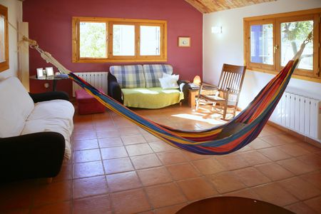 Nice living room with colorful hanged mexican hammock in Spain