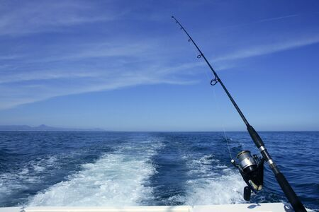 lines game: Fishing rod and reel on a boat, vacation on blue sea and summer sky