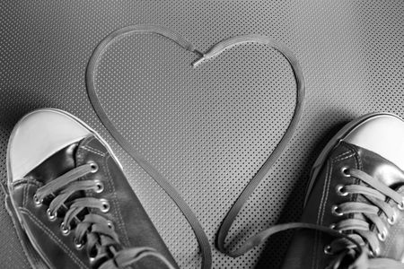 Laces of silver shoes, threads with heart valentines shape Stock Photo - 4699013